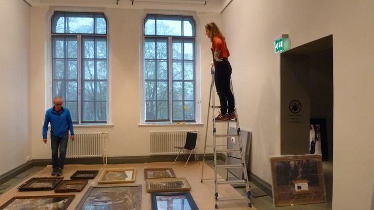 Artist Esko Männikkö and curator Maija Koskinen planning the installation
