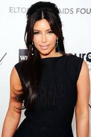 A voluminous ponytail would be a great idea. A gold necklace and big ear rings might glam up the look. A soft take on Veronica Lake waves is one of the favorite looks of Kardashian's past red carpet appearance. Discover more: Kim kardashian wedding, wedding hairstyles