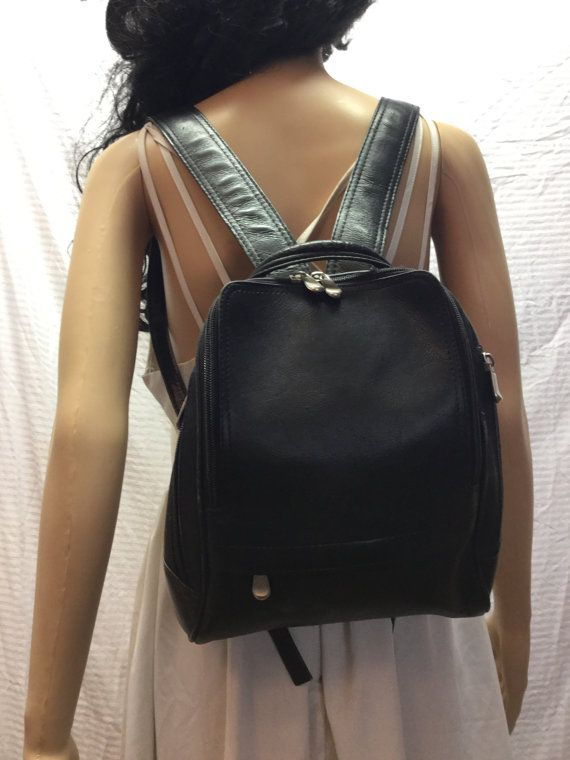 Le Donne Black Leather Backpack, Bag   Zip closure Fabric lined interior with one zip close pocket PLEASE SEE MEASUREMENTS Measures: W 8 1/2 x H 12 x Depth 4 Straps: Full length 33  Good condition.  Please remember when buying vintage purses there are normally minor imperfections unless these are very noticeable or detract from the style or attractiveness of the item they are not normally mentioned. LOOKING FOR PERFECTION - VINTAGE IS NOT FOR YOU! (Excellent Condition) MINT - As close to new…