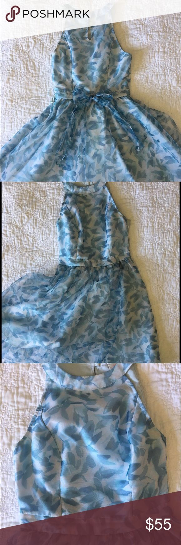 Blue and white party dress Lovely, blue and white print dress, with a high neckline and bow in the back. Bought for a wedding, never wore again. Lauren Conrad brand, from her Cinderella collection inspired by the live-action film. Perfect condition, with some foundation on inside of the front collar and sharpie on the tag. LC Lauren Conrad Dresses Mini