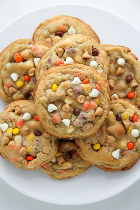 White Chocolate Reese's Pieces Peanut Butter Chip Cookies Recipe: Create this peanut butter perfection with white chocolate chips and Reese's Pieces baked into peanut butter cookies.