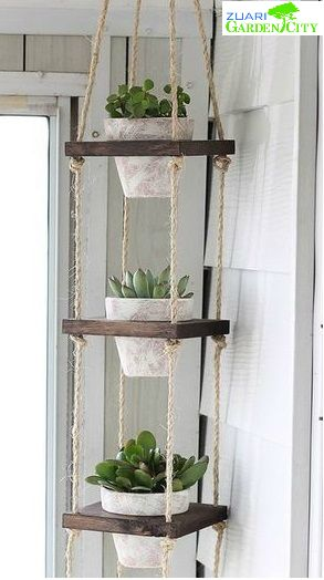 This plant hanger made by Scrapwood, Terra cotta pots, rope, Metal rings, Jigsaw, Sandpaper & Paint is ideal for small places. #doityourway