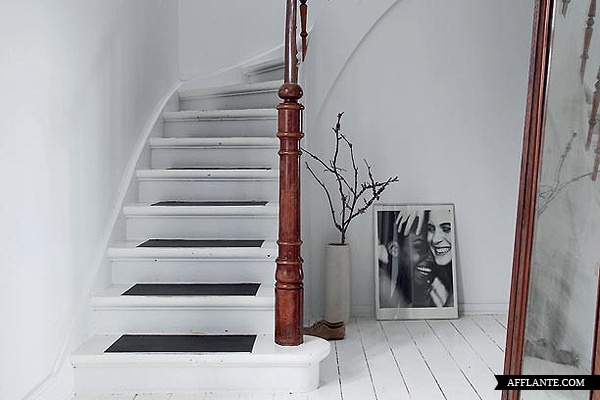 The beachside home of designer Naja Lauf. Look how stunning the wood looks against the white.