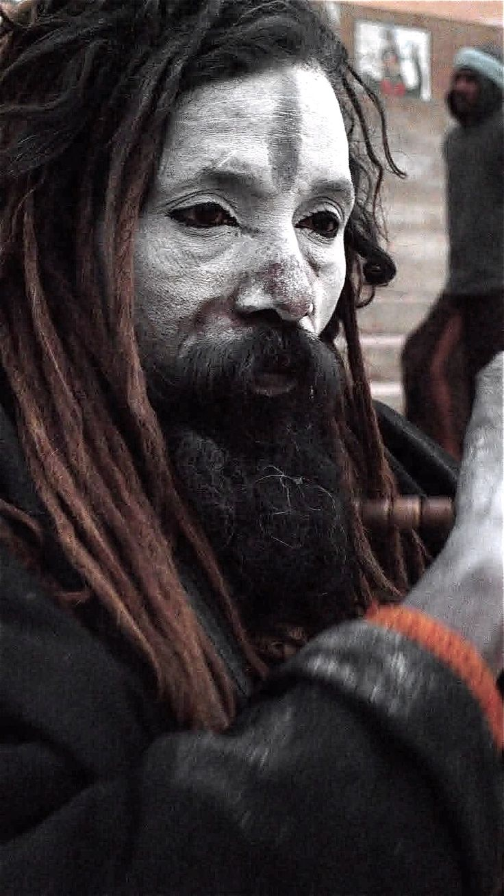 An Aghori man - http://www.cultofweird.com/culture/aghori-cannibal-hindu-monks/