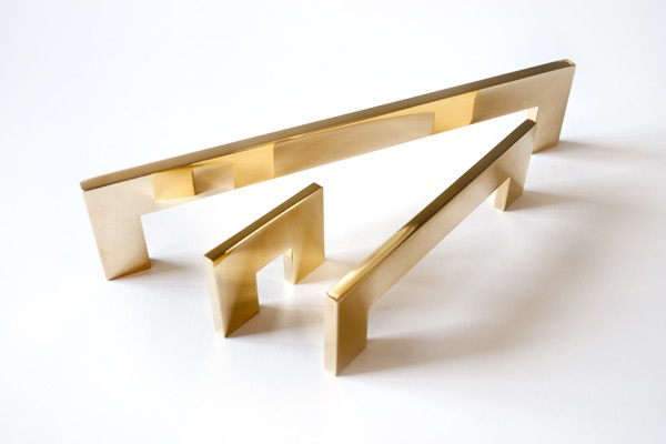 Heavy polished brass cabinet and drawer hardware from B Stockholm Sweden