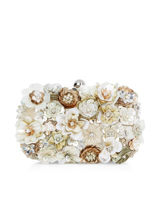 Come into bloom with our Chelsea hard-case clutch bag, lavishly embellished with clusters of 3D sequin flowers with faux pearl, sequin and bead decorations. Carry it in hand or wear it over your shoulder using the concealable chain strap.