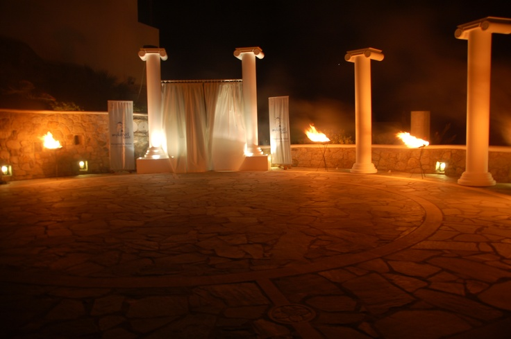 Greek decoration around the outdoor Amphitheater during a product presentation, at Mykonos Grand Hotel & Resort