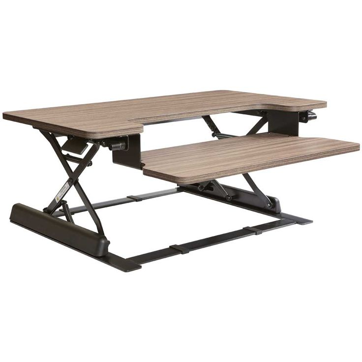This Height Adjustable Desk Riser is designed to transform your work office into a convenient work space. Turn your office desk from a sit-down to a standing desk with the addition of the Height Adjustable Desk Riser. The desk riser is designed to raise or lower to meet your current or future needs and with 10 different heights.  #desk #office #furniture #interiordesign #storage