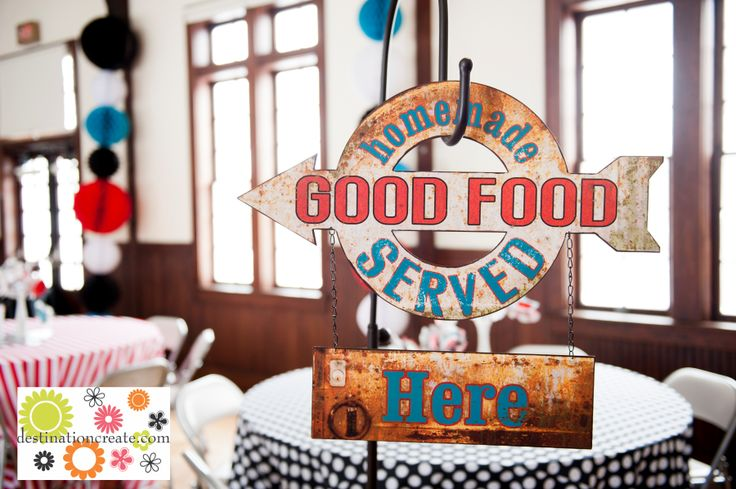 Vintage metal sign points to buffet at vintage retro wedding