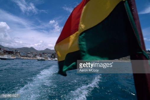 Stock Photo : Bolivia, South American flag flying with town of Copacabana in background, Bolivia, South America