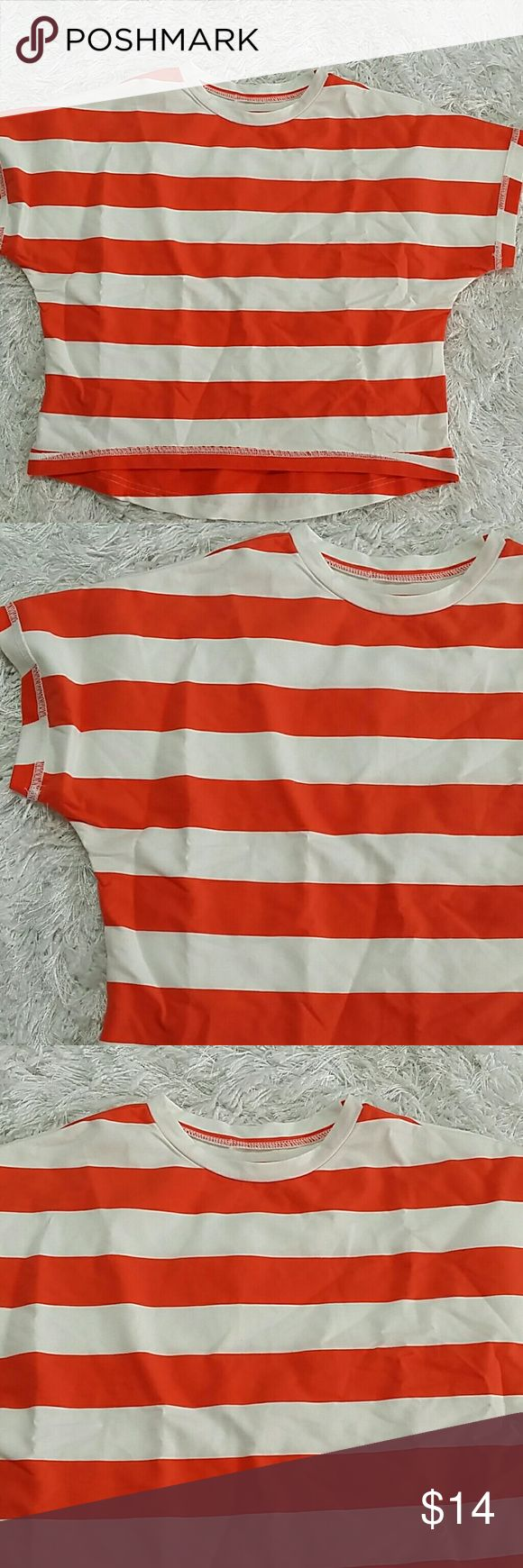 Orange Stripes Short Sleeves top.  Kids Adorable and over sized orange and white stripes top. Will fit 6 - 7 years. This item is brand new and never used. No tags. Shirts & Tops Tees - Short Sleeve