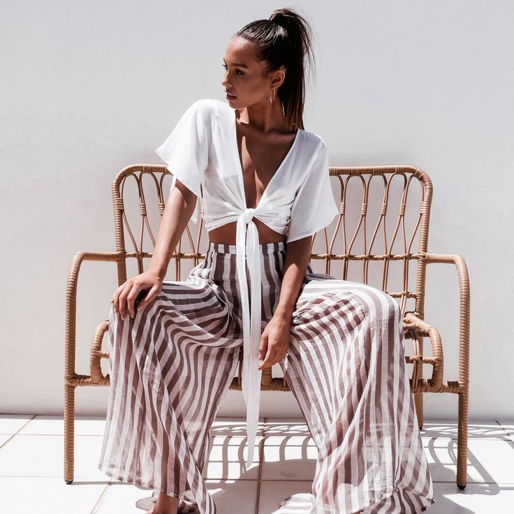 Wide pants: white wrap up blouse with wide vertical stripe pants. Perfect outfit for this summer vacation. Love how effortless and comfy this chic outfit is.
