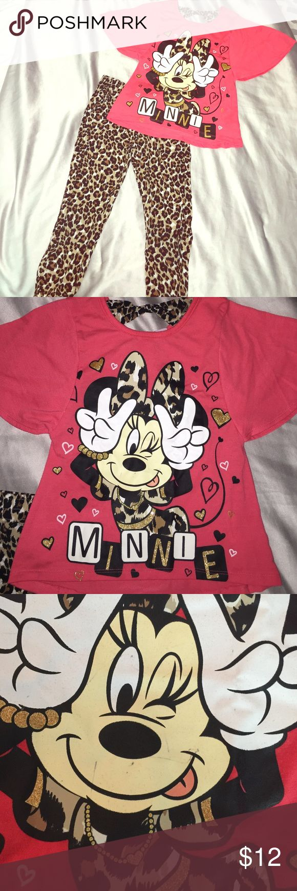 Winking Minnie Mouse Cheetah Outfit Gently used. A little ink marks on Minnie's face, but not very noticeable. An orange pink. Light wear and tear. XS girls 4/5 Disney Matching Sets