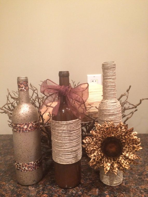 I love this set of bottles with animal print accents and flower added plus the rustic twine wrap.