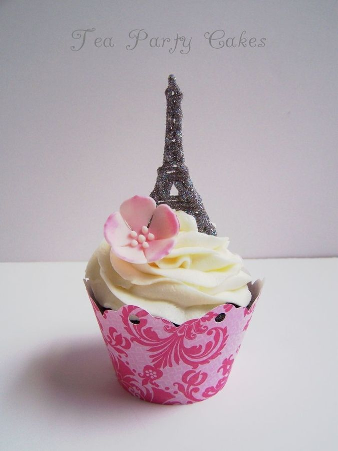 Cupcakes I made for a little girl's birthday who loves Paris and the Eiffel Tower.  The Eiffel Tower is a piped chocolate transfer covered in edible disco dust.-photo.
