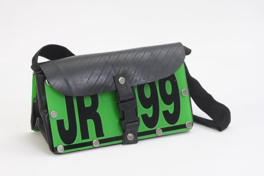These amazing recycled car registration number plate handbags come to you direct from South Africa and have been Fairly Traded.  Each bag is made from an assortment of cut car number plates and then fitted with pieces of recycled car tyre inner tubes to create the top of the bag and then finished-off with black vinyl sides and base.  The bag fastens with a plastic clip at the front.