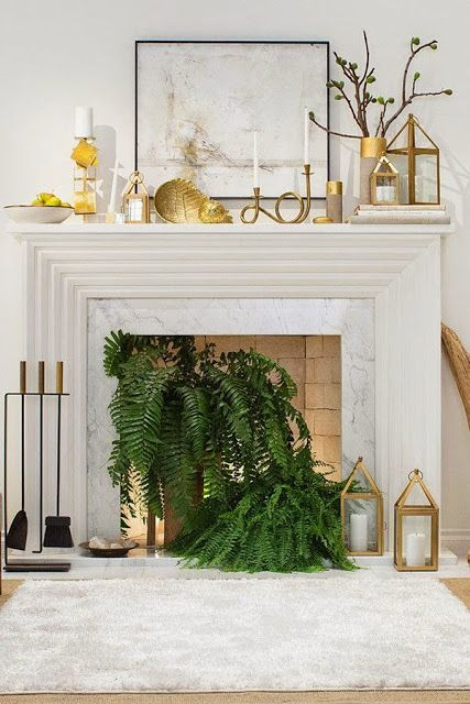 East Meets South: Living Room Update: Ferns in the Fireplace, brass lanterns