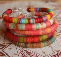 Silk yarn wrapped bracelets  I may be in love!