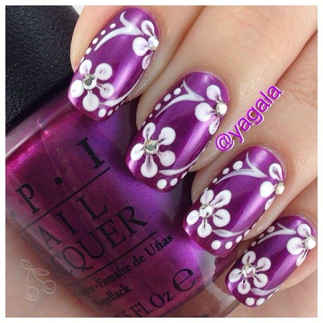 yagala #nail #nails #nailart purple fingernail polish design with white flowers n gemstones