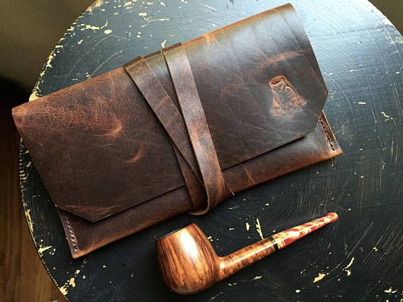 This is The Gent Pipe Pouch. Carries the essentials, tough as nails, handsome as hell. Holds: 1 pipe, tamper, lighter, and a 1/2 ounce of tobacco, all in separate pockets, for maximum protection of even your best pipes. The hand cut strap securely holds everything in place, and doubles as a loop on the inside to even hold your pipe cleaners. Everything you need for a hike, day trip, or night out, all in a neat package that fits inside a jacket pocket.  Handmade in the USA: This one comes...