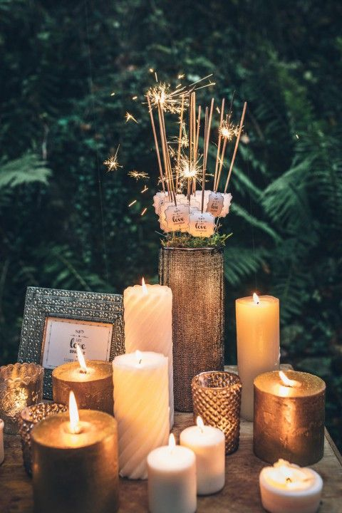 Give everyone four sparklers. Have a table of candles so everyone can light there first sparkler for a smoothly timed send off.