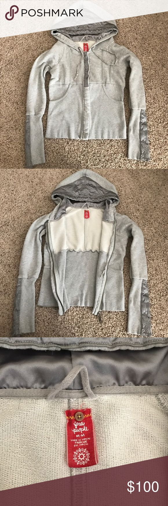 Free People zip up hoodie sweater Grey zip up hoodie, sleeve and hood detail with embroidery (see photos). Free People Jackets & Coats