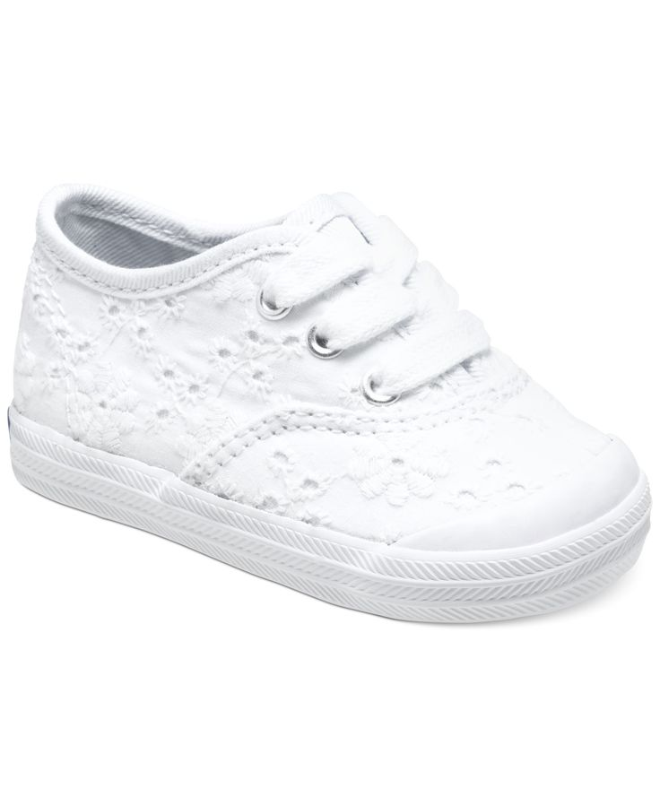 A fun look is underfoot. She'll be adorable in eyelet embroidery and a cute toecap from Keds. | Textile upper; Rubber sole | Wipe clean | Imported | Keds baby girls' sneakers | Floral embroidery at up