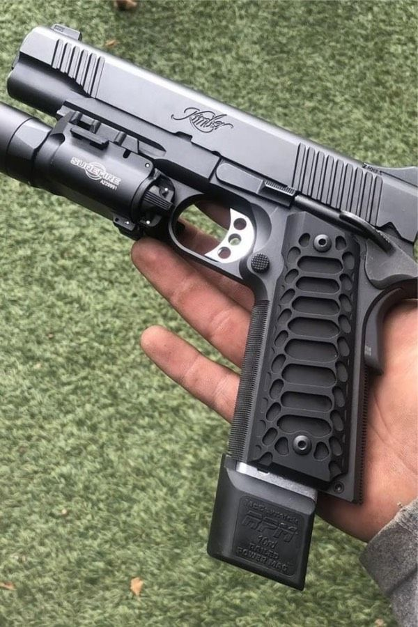 How sick is this modded 1911 Kimber? Love the grip and mag