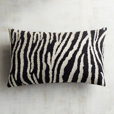 Think our zebra-inspired pillow is too wild for your taste? We say think again. Whether placed on a neutral leather sofa or a hot pink chair, our handcrafted  addition is sure to make your room come to life.