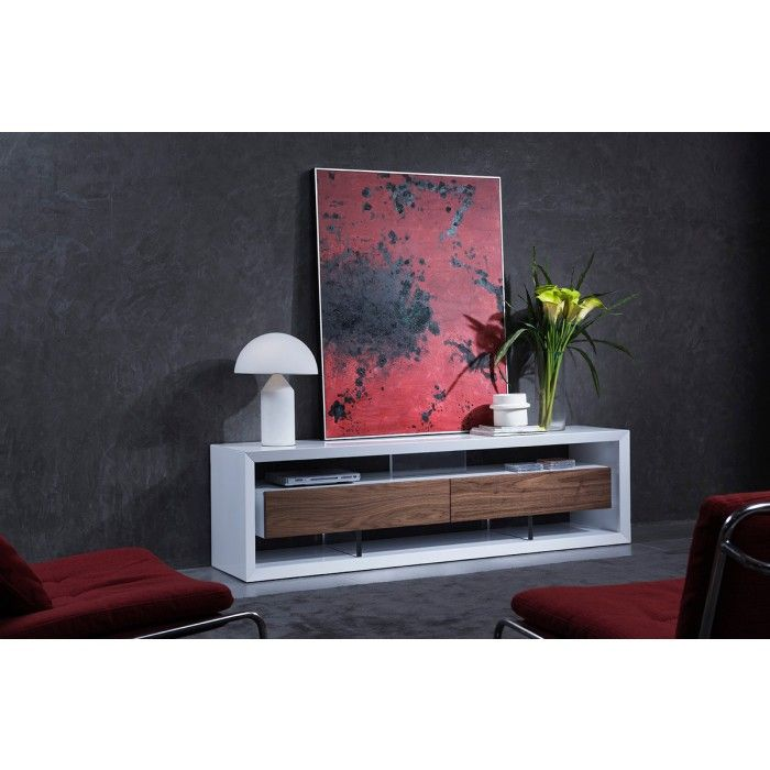 The Modrest Manvel Contemporary White & Walnut TV Stand evokes posh and style featuring a white gloss finished body and 2 drawers with Walnut veneer fronts. The drawers were made to look suspended with clear acrylic supports that made way for open shelves over and under the drawers. This contemporary TV stand requires no assembly.