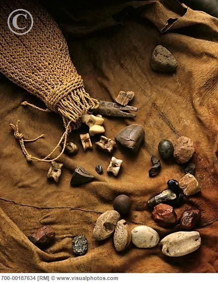 Divination: Throwing the bones, South Africa ~ A Sangoma's (traditional healer's) bag for divination, containing 30 animal vertebrae, 2 pebbles, a hoof, 2 pieces of carved bone, and a nut shell.