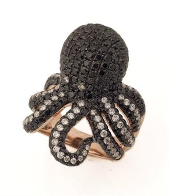 A fine black and white diamond 'octopus' dress ring, the rose coloured 18 carat gold ring designed as an octopus, the body pave set with black diamonds and with black and white coloured diamond tentacles, total weight of black diamonds, 4.46 carats, total weight of white diamonds, 0.94 carats, total approximate weight, 12.5 grammes.