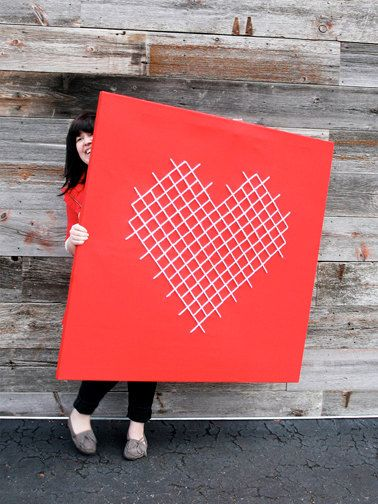 This supersized crafty cross stitch heart would be right at home at a DIY wedding reception. #MarthaStewartWeddingsMagazine