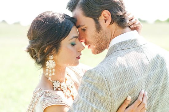 I love the touches of Indian Jewelry here, and this pose. Very close and romantic daytime photo.
