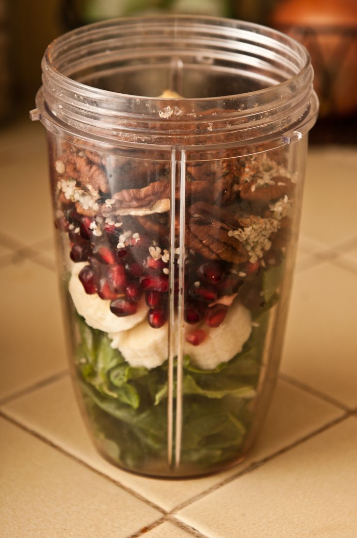 Romaine Lettuce, Banana, Pomegranate Seeds (1/2 cup), Raw Pecans, Hemp Seeds, Ground Cinnamon, Ground Cloves, Fresh Ginger Root, Add Almond Milk (and ice, if desired) & Blend.