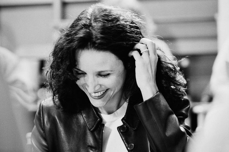 """Rare Photos From The Final Days Of """"Seinfeld"""". Julia smiles as she reads the final script."""