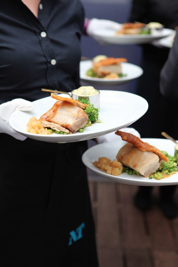 Middle white slow-roasted pork belly with sage and onion mash, Bramley apple compote, buttered greens and Calvados jus