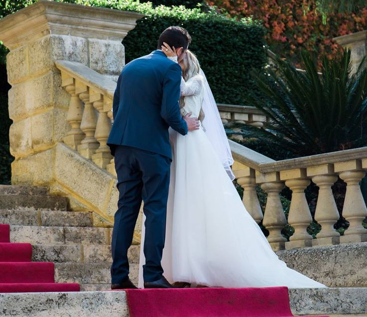 Bride and groom first kiss during reception at Caversham House  Timika Prygoda Woodnote Photography