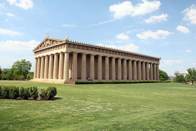Nashville, TN - The Parthenon in Nashville definitely doesn't look as weathered as the Parthenon in Athens, built in 438 BC. But on a summer day while you set up your blanket on the field you can imagine yourself as part of the Greek gods and goddesses. There's something a little more magical about having a picnic or playing frisbee with a massive Greek temple behind you. The inside functions as an art museum and you can check out the statue of Athena Parthenos, a giant and meticulously…