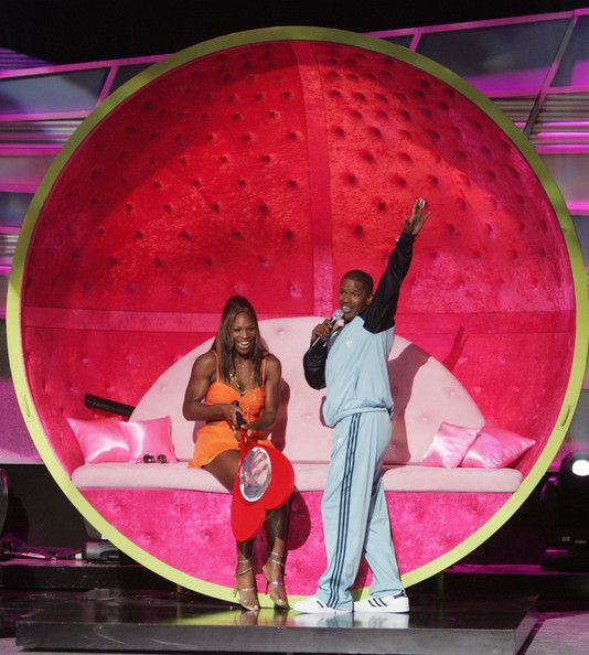 Host Jamie Foxx serenades tennis player Serena Williams on stage at the 12th Annual ESPY Awards held at the Kodak Theatre on July 14, 2004 in Hollywood, California. This year's ESPY's will air Sunday, July 16th on ESPN beginning 9 PM EST/6 PM EST. - The 12th Annual ESPY Awards - Show