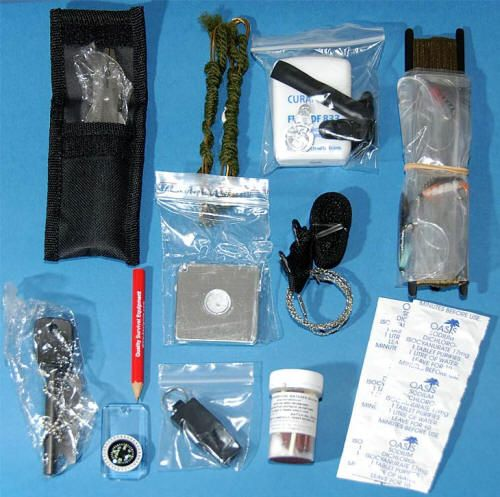Special Forces Survival Kit  Contents & Specs:  Nylon windowed pouch  Flexible tubing  Air-tight re-sealable bag  Fireball Flint  Mini-Compass  Brass snares  Mayday signal mirror  Suspender clips  Fishing Kit  Flexible Tubing  Size: 11.8 x 9 in  	    Tinder cards  NATO Survival Matches  Fine cord (20m)  Stainless steel multi-tool  Sail needles  Water bag  Needle threader  Water tablets  Commando Wire Saw  Tornado whistle  Green plastic survival bag  Weight: 13.5oz
