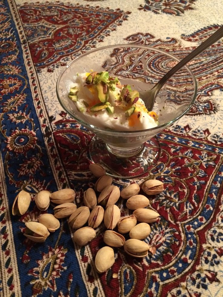 Persian ice cream. Add 1/4 teaspoon saffron dissolved in rosewater to vanilla ice cream. Top with crushed pistachios.