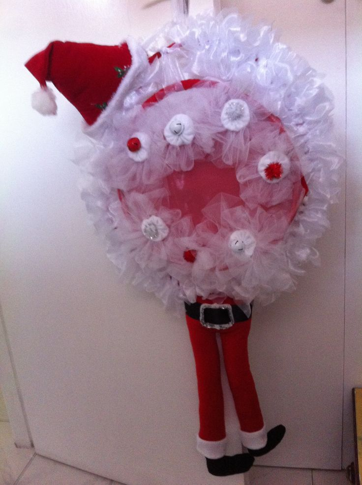 Satin ribbon, felt, fleece Elf Xmas wreath made by member of Gabbies sewing angels find us on Facebook.
