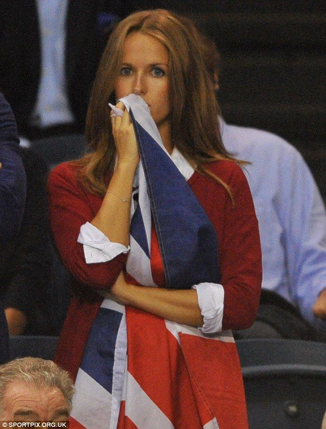 Kim, wearing a baggy red jumper, looked nervous when Andy lost a few points in his opening...