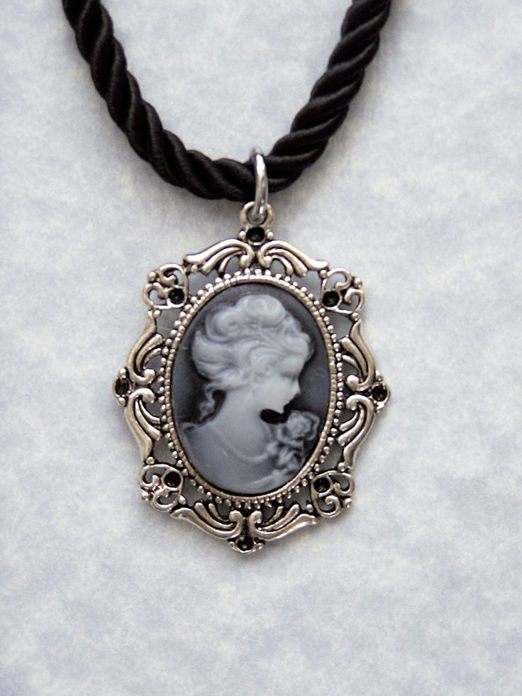 A personal favorite from my Etsy shop https://www.etsy.com/ca/listing/250172867/antique-silver-blue-gray-victorian-lady