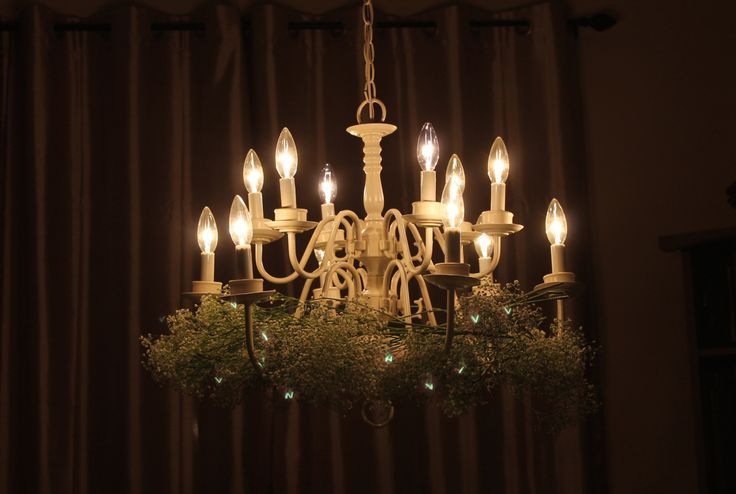 Baby's breath crown on chandelier for table decor