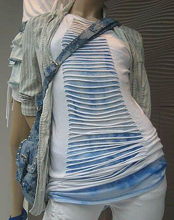 So what you do are very simple, fold your t-shirt in half, so that the crease is in the exact middle of the shirt. Then cut some slits from the top down to the bottom. But make sure you don't cut too low, leave a certain inches at the end. Then after that you stretch these slits so they look like spaghetti