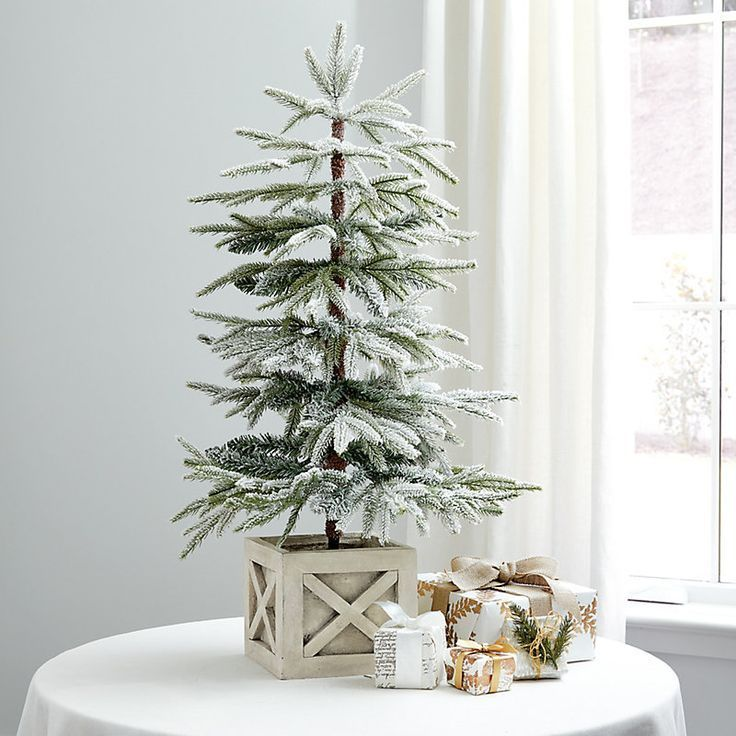 The Soft Faux Spruce Branches Look Like They Re Dusted With Freshly Fallen Snow This Flocked Tabletop In 2020 Artificial Christmas Tree Christmas Table Christmas Tree