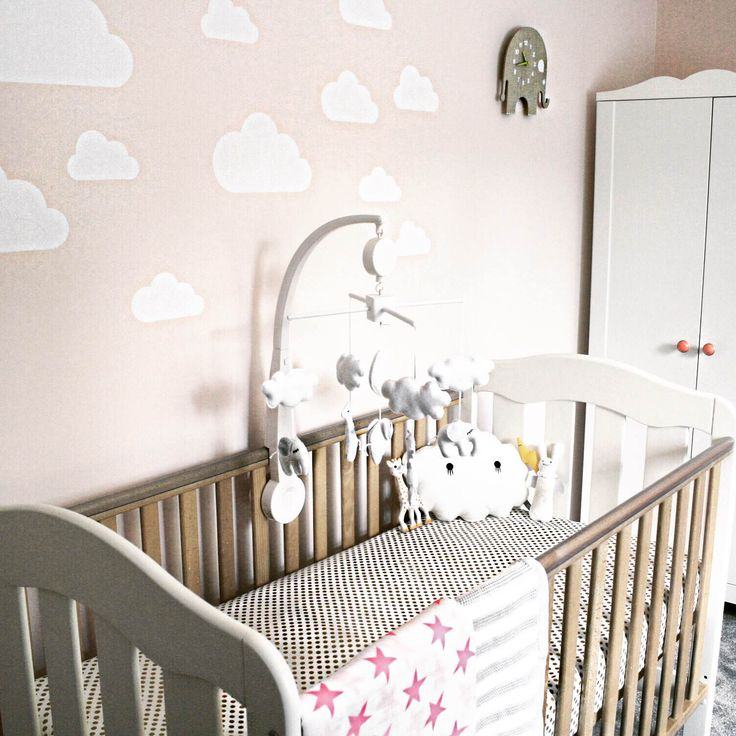 Clouds and patterns over the bi-colour cot bed!