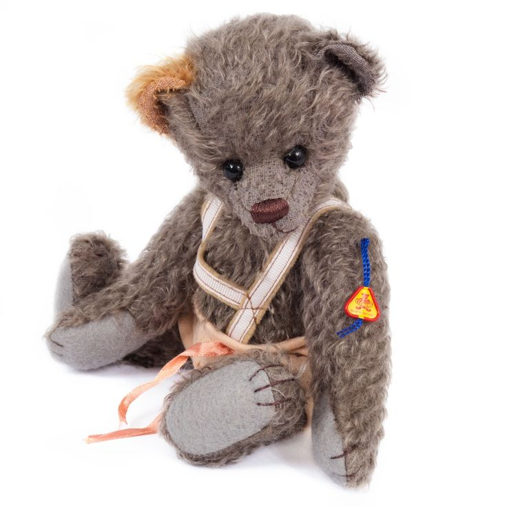 Teddy Max is an exceptional example of a classic European teddy bear.  He is crafted with the finest grey mohair/wool blend fabric and features extraordinary attention to detail and classic styling and perfect stitching. This is a teddy bear to love and cherish for many years.
